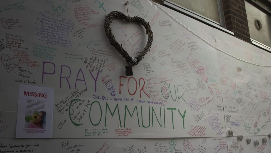 """One of the local makeshift community walls around the Grenfell Tower fire site on which people posted their thoughts and condolences. Most prominent of all was daubed: """"Pray for our community"""""""