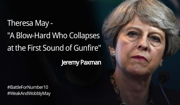 Photo of a grim-faced Theresa May captioned with a quote from Jeremy Paxman: A blow-hard who collapses at the first sound of gunfire.