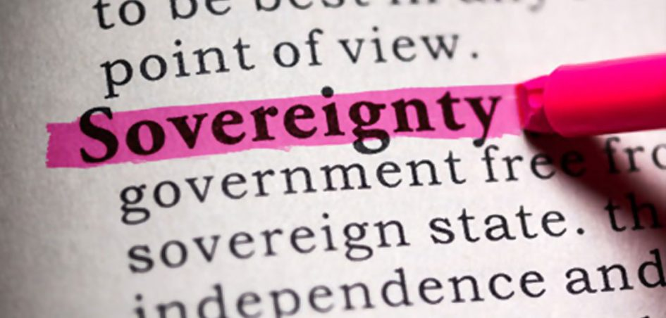 Partial photo capture of a dictionary page with the word Sovereignty highlighted by a pink highlighter pen
