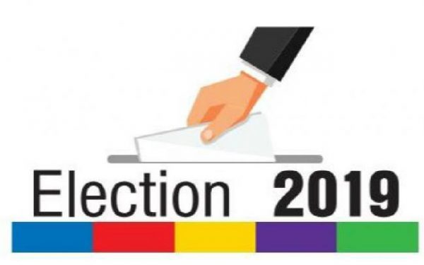 Image of a vote being posted by a disembodied hand for UK election 2019.